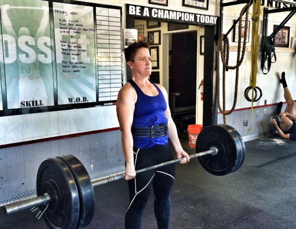 This is a photo of a woman deadlifing a barbell