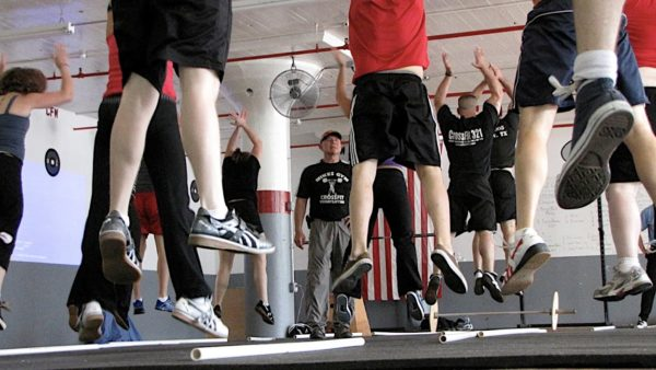 feet of people jumping in a gym